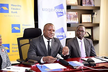 Mr. Mathias Katamba, Managing Director, Housing Finance Bank (L), and Mr. Walter Wafula, Business Unit Head -PR, brainchild Burson-Marsteller (R) at a press briefing at the bank's Head office in Kololo  on April 10th, 2018.